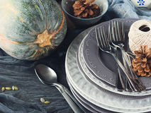 Thanksgiving dinner still life with dishes and cutlery. Toned Royalty Free Stock Image