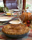 Thanksgiving dinner table with apple pie Stock Photo