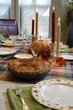 Thanksgiving dinner table with apple pie Royalty Free Stock Photography
