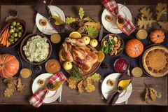 Thanksgiving dinner table. Thanksgiving Celebration Traditional Dinner Setting Food Concept. Thanksgiving Turkey with all sides on table, lots of seasonal stock photo