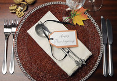 Thanksgiving dinner table place setting - Aerial view. Beautiful Autumn Fall theme Thanksgiving dinner table place setting with Happy Thanksgiving tag attached Royalty Free Stock Photo