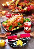 Thanksgiving dinner table served with turkey. Decorated with bright autumn leaves royalty free stock photo