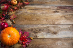 Thanksgiving or fall greeting background with orange pumpkins a. Nd fall leaves. Thanksgiving background with seasonal vegetables and fruits. Fall background royalty free stock photo