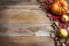 Thanksgiving or fall greeting with orange pumpkins, berries and Stock Photography