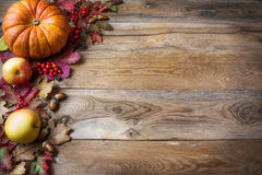 Thanksgiving or fall greeting with pumpkins, berries and fall le