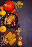 Thanksgiving food concept. Harvest or Thanksgiving background. Chicken or turkey, autumn fruits and vegetables: corn, pumpkin, paprika, apples. Cranberry sauce stock photo