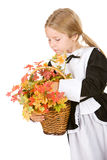 Thanksgiving: Girl Pilgrim Holding Basket Of Autumn Leaves And F Royalty Free Stock Image