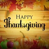 Thanksgiving greeting card with leaves, pumpkin on wood background. Stock Photo