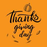 Thanksgiving greeting design with pumpkin, other vegetables, autumn leaves, and calligraphy inscription Thanksgiving Day Royalty Free Stock Photography