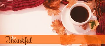Composite image of thanksgiving greeting text. Thanksgiving greeting text against cup of black tea with autumn leaves and woolen cloth on white background Stock Photography