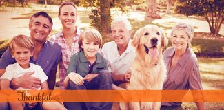Composite image of thanksgiving greeting text. Thanksgiving greeting text against happy family smiling with dog Stock Image