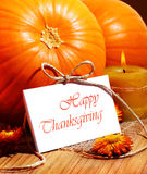Thanksgiving holiday card. Thanksgiving holiday, pumpkin still life decoration with candle on the wooden table, greeting card with text space, harvest concept Stock Photography
