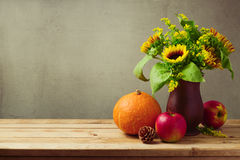 Thanksgiving holiday concept with sunflowers and pumpkin on wooden table Royalty Free Stock Image