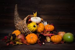Thanksgiving or fall cornucopia. A Thanksgiving holiday decorative cornucopia with pumpkins, squash, leaves etc Stock Photo