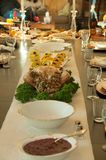 Thanksgiving Holiday Table Setting for Turkey. Holiday Thanksgiving turkey set on a table with other meal dishes Royalty Free Stock Image