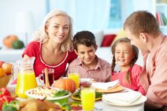 Thanksgiving joy. Portrait of happy family gathered at festive table on Thanksgiving Day Stock Image