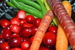 Thanksgiving kitchen healthy Food Cranberry. Cranberry, colorful carrots, yellow and green beans piled in a glass bowl Ingredients for healthy thanksgiving stock photography
