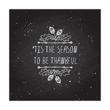 Thanksgiving label with text on chalkboard background Royalty Free Stock Photos