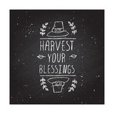 Thanksgiving label with text on chalkboard background Royalty Free Stock Photography