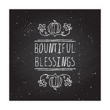 Thanksgiving label with text on chalkboard background Royalty Free Stock Images