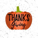 Thanksgiving lettering typography design with pumpkin and burst on a old textured grunge effect background. Vector Stock Photos