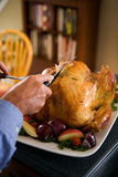 Thanksgiving: Man Cuts Into Turkey Breast With Carving Tools Stock Photo