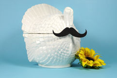 Thanksgiving Mustache on a vintage turkey tureen with sunflower Stock Image