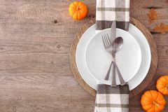 Free Thanksgiving Or Fall Harvest Table Setting, Top View, Side Border Against A Wood Background Royalty Free Stock Photo - 160251075