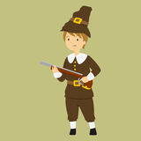 Thanksgiving Pilgrim Boy Carrying a Rifle Stock Images