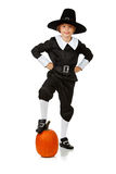 Thanksgiving: Pilgrim With Foot On Pumpkin Royalty Free Stock Images