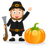 Thanksgiving Pilgrim with Rifle and Pumpkin Royalty Free Stock Images