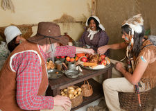 Thanksgiving pilgrims eating Stock Image