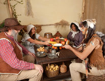 Thanksgiving pilgrims eating Royalty Free Stock Photography