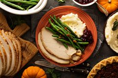 Thanksgiving plate with turkey, mashed potatoes and green beans. Thanksgiving plate with turkey, mashed potatoes, green beans and cranberry sauce royalty free stock photo