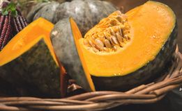 Sliced pumpkin in Thanksgiving Harvest basket Stock Photo