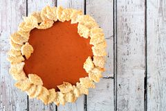 Thanksgiving pumpkin pie, above view on white wood Stock Images
