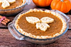 Thanksgiving pumpkin pie with leaf pastry toppings Stock Images