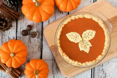 Thanksgiving pumpkin pie with leaf pastry toppings on white wood Stock Photo
