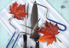 Thanksgiving roast turkey carving utensils set on pale blue background Stock Photo