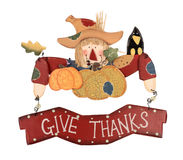 Thanksgiving Scarecrow. Wooden thanksgiving scarecrow decoration with a sign give thanks isolated on white Royalty Free Stock Image