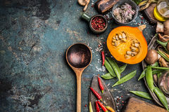 Thanksgiving seasonal cooking with Healthy and organic harvest vegetables and ingredients: pumpkin, Pea,chili,Mushrooms with woode Royalty Free Stock Photo