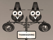 Thanksgiving. Sepia Thanksgiving comical Pilgrim Father birds perched on a lamppost Royalty Free Stock Images