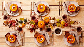 Thanksgiving setting of pumpkin soup for six Royalty Free Stock Images