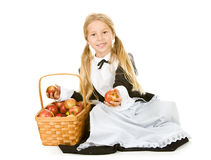 Thanksgiving: Smiling Pilgrim Girl Holding Basket Of Apples Royalty Free Stock Photography