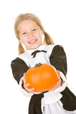Thanksgiving: Smiling Pilgrim Girl Holding Pumpkin Stock Photography