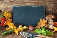 Thanksgiving still life with mushrooms, seasonal fruit and veget Royalty Free Stock Image