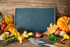 Thanksgiving still life with mushrooms, seasonal fruit and veget. Ables on wooden table with space for text. Cooking concept stock photography