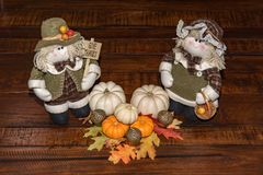 Thanksgiving Table Center Piece with Pilgrims showing Give Thanks sign stock photo