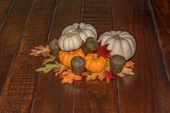 Thanksgiving Table Center Piece Center of Table. Thanksgiving Table Center Piece with and orange mini pumpkins on a wooden table Stock Image