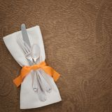Thanksgiving Table Place Setting with silverware, Cloth Napkin on Brown Damask Textured Tablecloth with room or space for copy, te. Xt, your words. Square crop Stock Photo